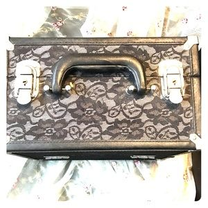 Black lace makeup train case